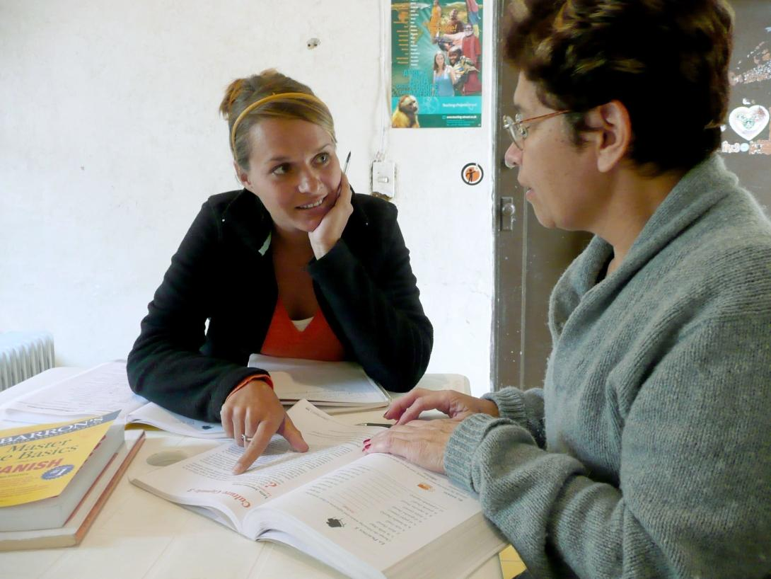 A volunteer on a Spanish language course in Mexico attends a lesson with her tutor.